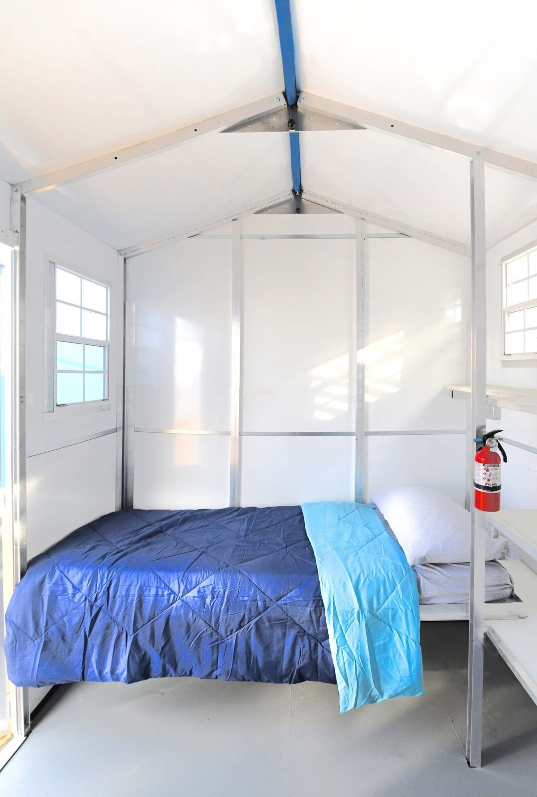 Bedroom, Bed, and Storage Due to the pandemic, each unit will only be used to house one person with exceptions made for couples and a parent with a child.   Photo 6 of 12 in L.A. Is Taking On Homelessness With a New, Brightly Colored Tiny Home Village