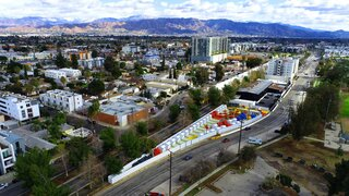Located across the street from North Hollywood Park, this 40-unit tiny prefab village is the first of its kind in Los Angeles and has already reached full capacity.