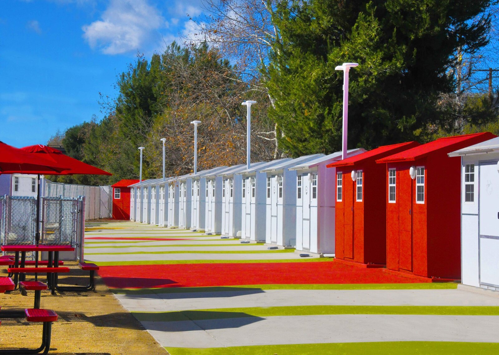 Exterior, Prefab Building Type, Gable RoofLine, and Tiny Home Building Type The Chandler Boulevard prefabs measure 8-feet-by-8-feet each and can be dismantled and reassembled at least 40 times for storage or relocation.   Photo 7 of 12 in L.A. Is Taking On Homelessness With a New, Brightly Colored Tiny Home Village
