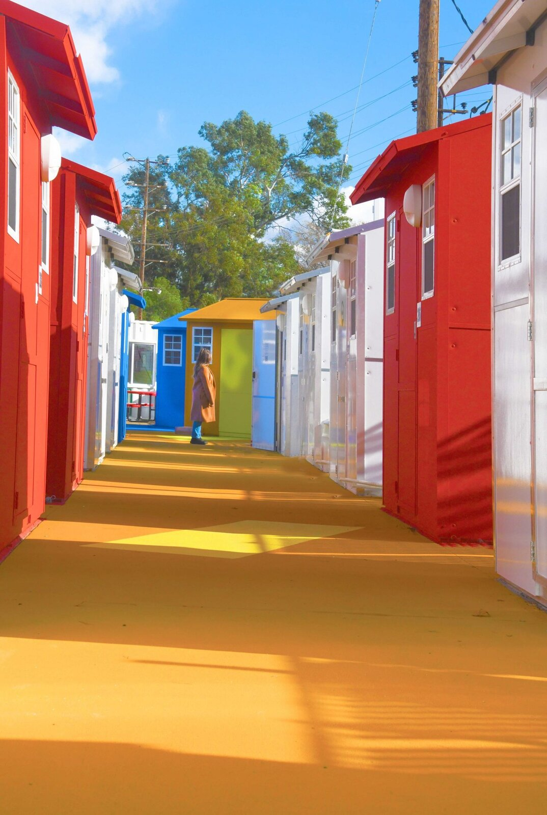 Exterior, Gable RoofLine, Tiny Home Building Type, and Prefab Building Type The tiny house community also has ADA units to accommodate people with wheelchairs.   Photo 8 of 12 in L.A. Is Taking On Homelessness With a New, Brightly Colored Tiny Home Village