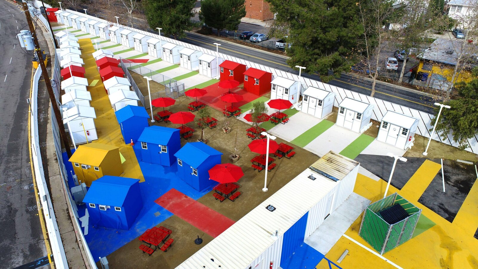 Exterior, Prefab Building Type, Tiny Home Building Type, and Gable RoofLine To live here, residents had to be homeless, 18 years and older and living within a three-mile radius.  Photo 2 of 12 in L.A. Is Taking On Homelessness With a New, Brightly Colored Tiny Home Village