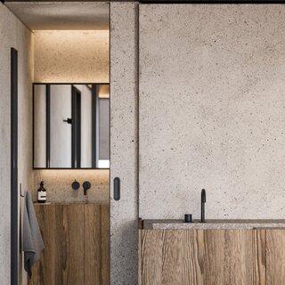 Minimalist sliding doors separate the rooms.