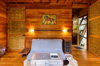 The open-plan living area on the first floor includes a futon sofa that folds out into a double bed. A family trunk was repurposed into the coffee table.
