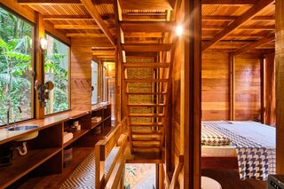 Garapera, a tropical hardwood, is used extensively throughout the cabin, including the ceilings, floors, walls, stairs and exterior for a unified appearance.
