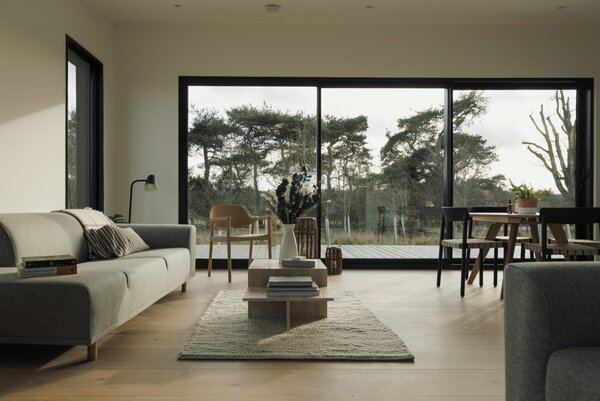 Large windows let in an abundance of natural light and views of the landscape.