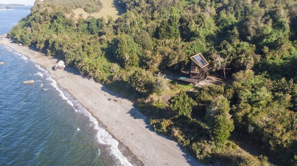 Located in southern Chile's Lake District at San Agustín, ZeroCabin Krul backs into a forest and faces an inlet of the Pacific Ocean. The cabin is also close to the Andes mountains and the Patagonian fjords.