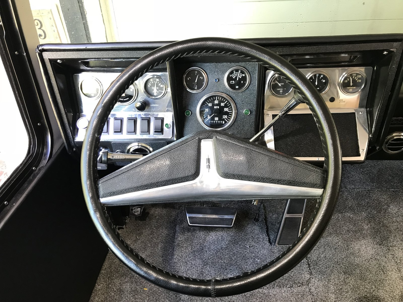"Finished dash and steering wheel. Aluminum and black is the theme for the cab. Photo 13 of Flatnose Frank: Our Renovated Vintage RevCon Motorhome (""Is that an Airstream?"") modern home"