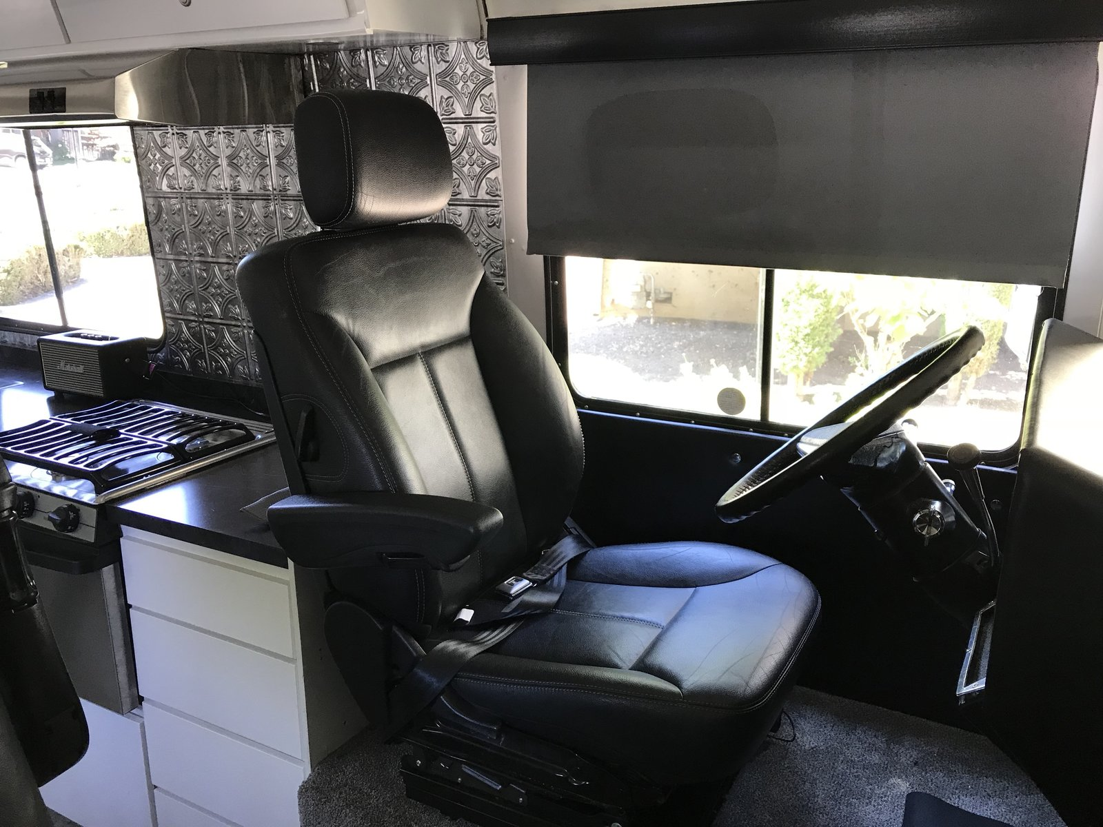 "Retrofit Mercedes GL450 leather, 6-motor driver's seat is fully adjustable, swivels 90 degrees , and is super comfortable. Photo 15 of Flatnose Frank: Our Renovated Vintage RevCon Motorhome (""Is that an Airstream?"") modern home"