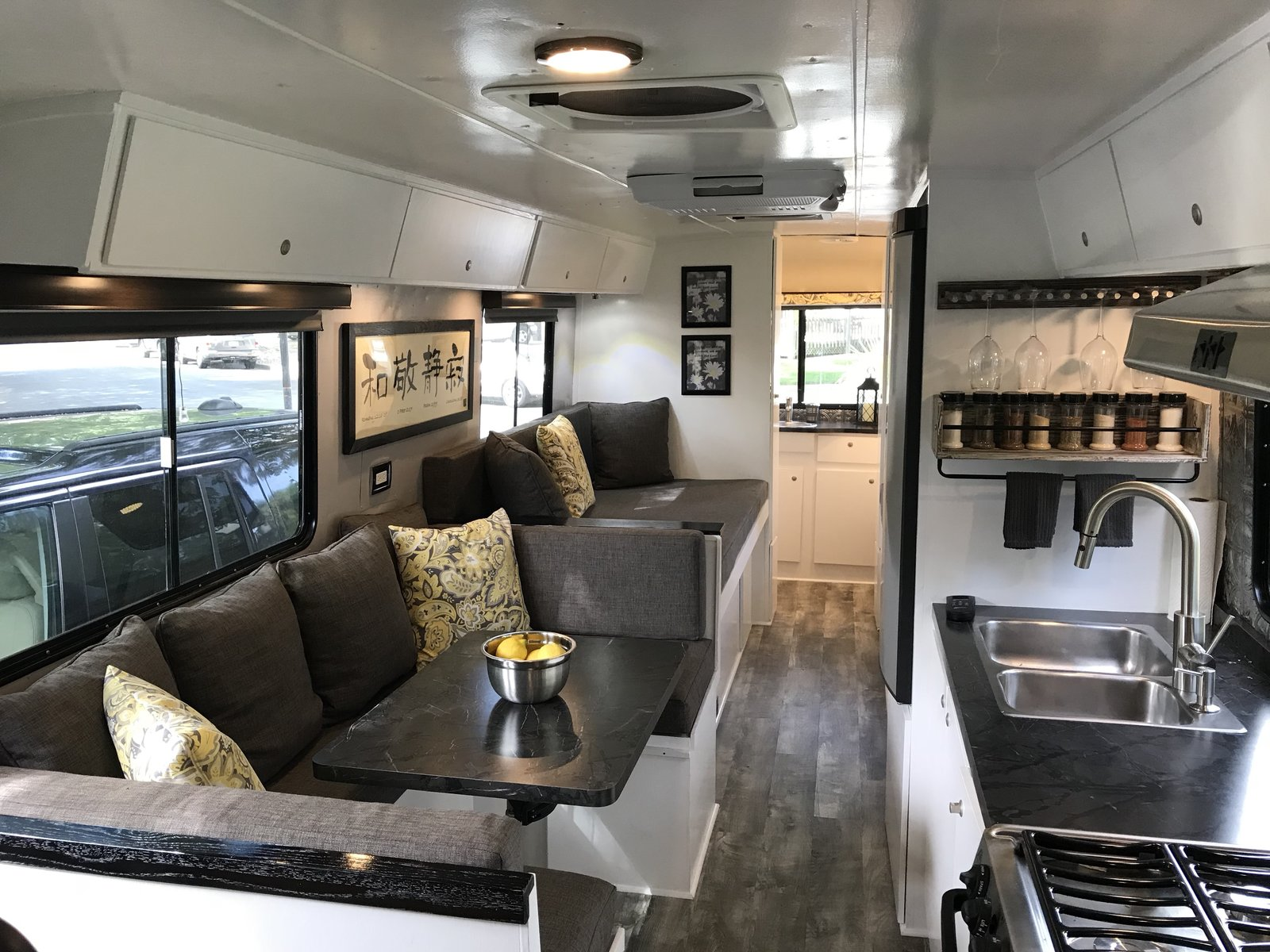 "Modern home with Dining Room, Medium Hardwood Floor, Bench, Table, and Recessed Lighting. This is the finished main area fully designed by my talented wife. Photo 17 of Flatnose Frank: Our Renovated Vintage RevCon Motorhome (""Is that an Airstream?"")"