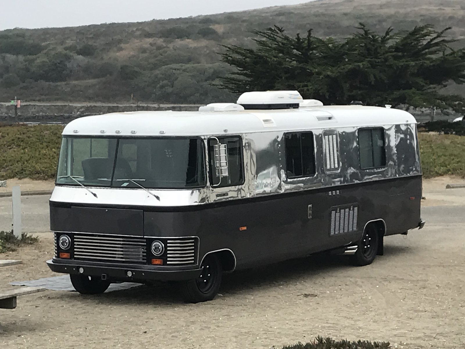 "Modern home with Outdoor. Frank's home is on the road, near the beach Photo 22 of Flatnose Frank: Our Renovated Vintage RevCon Motorhome (""Is that an Airstream?"")"