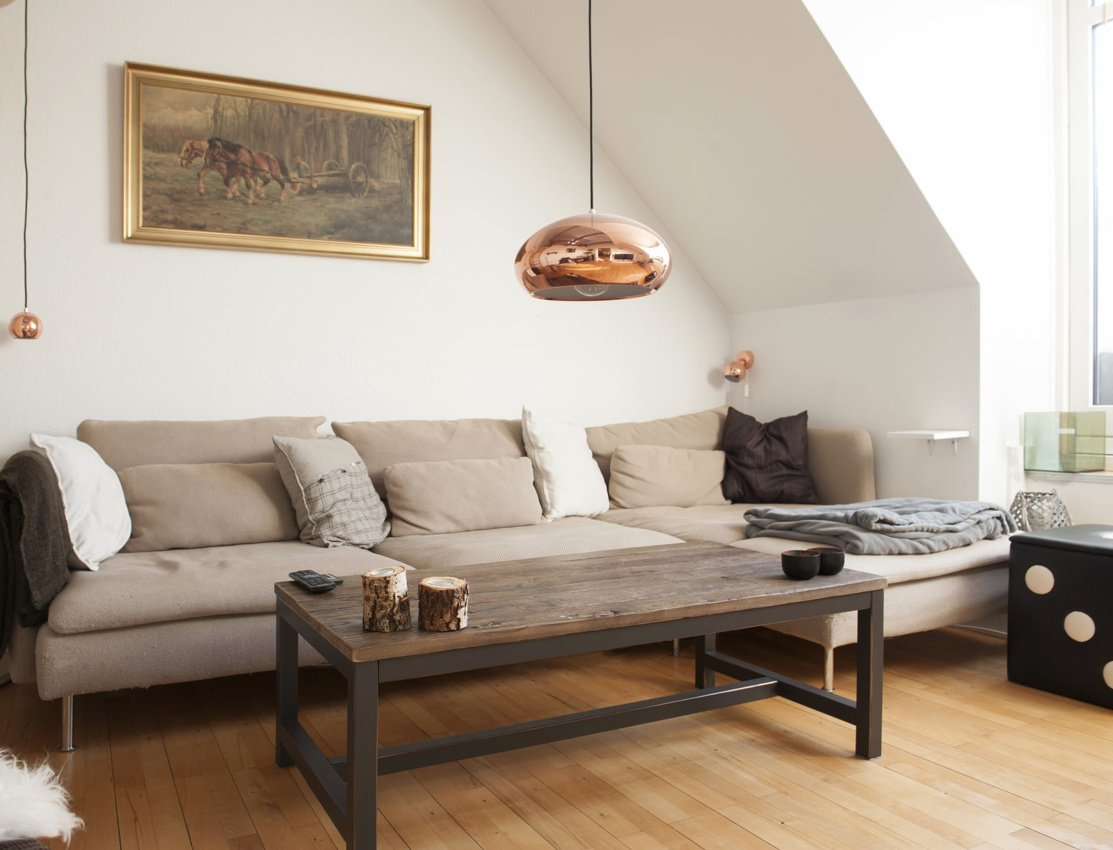 Living Room, Sofa, Coffee Tables, Pendant Lighting, and Medium Hardwood Floor copper and brown living room  Bringing Nature Inside by Petra Ford