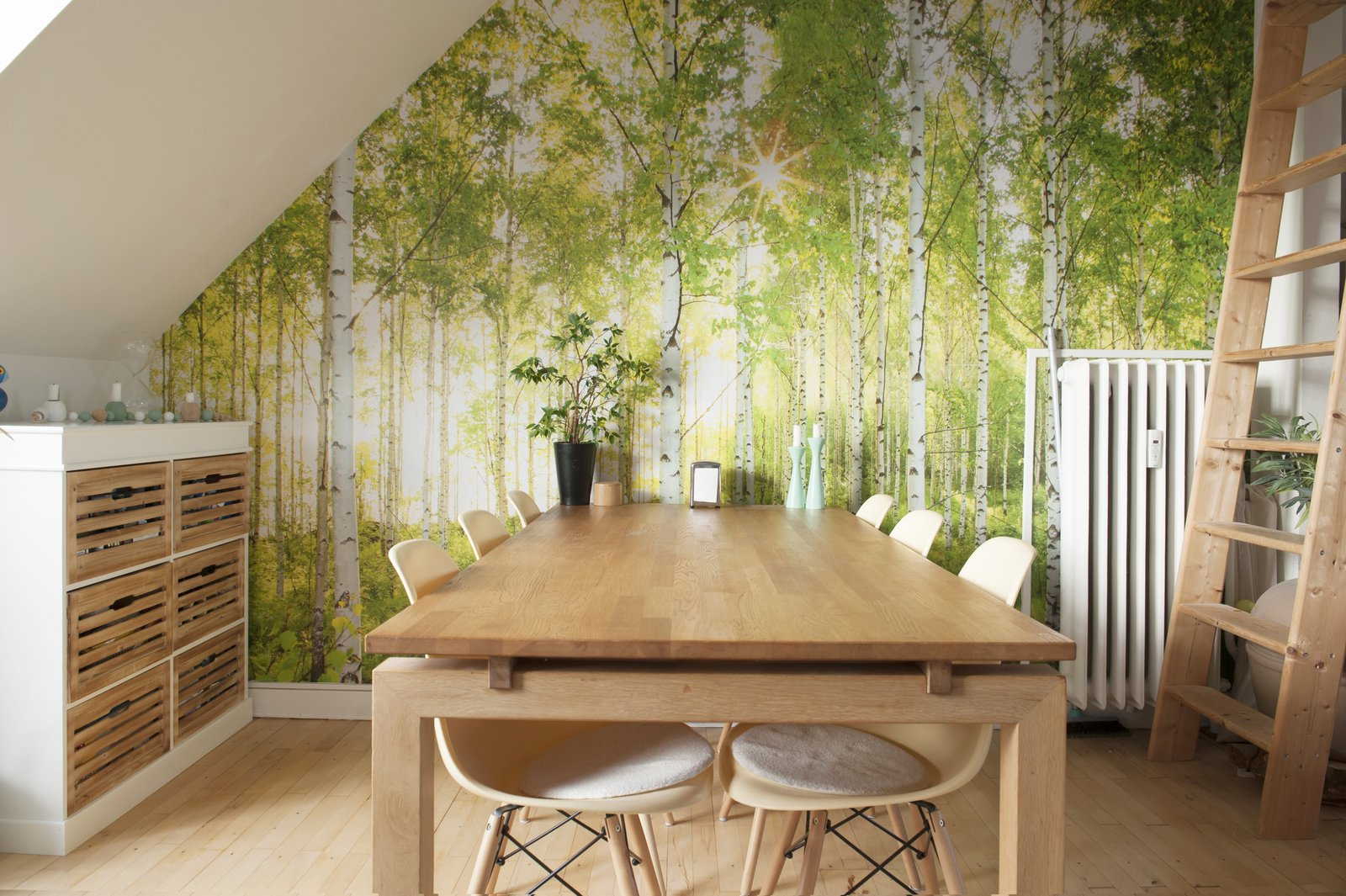 Dining Room, Table, Storage, and Medium Hardwood Floor wooden dining table, storage drawers, and ladder add an earthy feel to the forest wallpaper  Bringing Nature Inside by Petra Ford