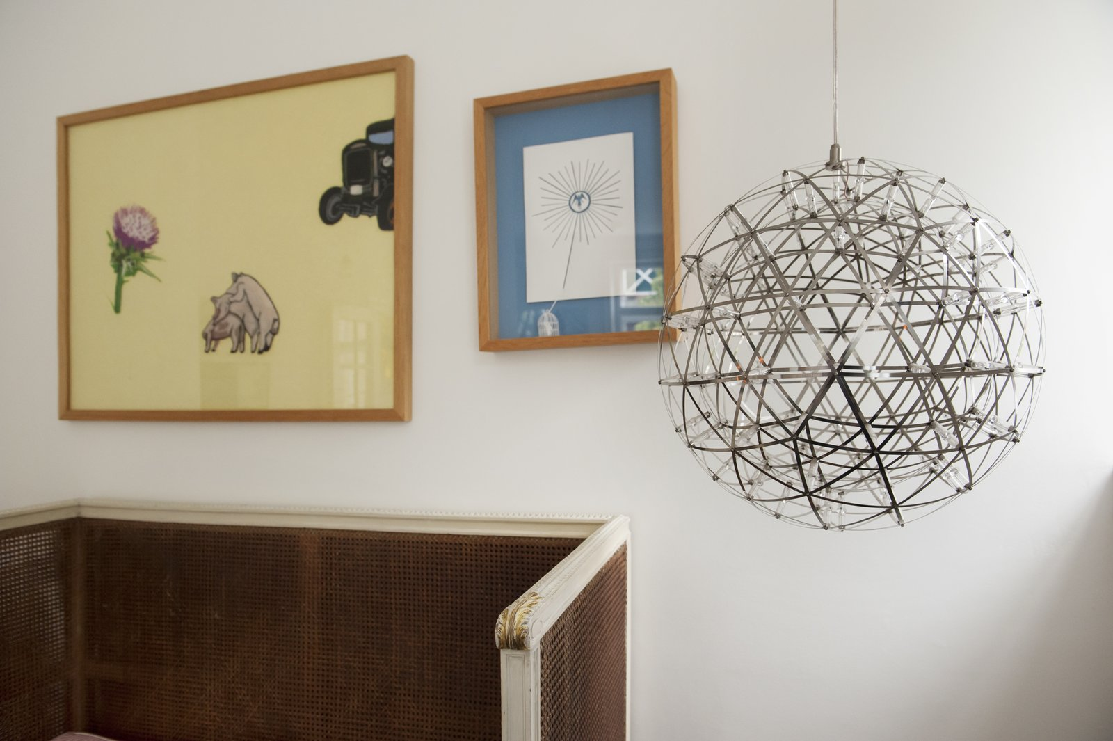 Living Room, Pendant Lighting, and Bench Contemporary metal globe pendant light juxtaposes unique original artwork.  Colorful & Eclectic Danish Home by Petra Ford