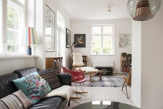 The eclectic living room is full of different patterns and types of material.