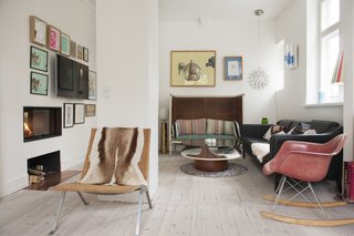 Living area features a collection of chairs, rockers, sofas, and benches.