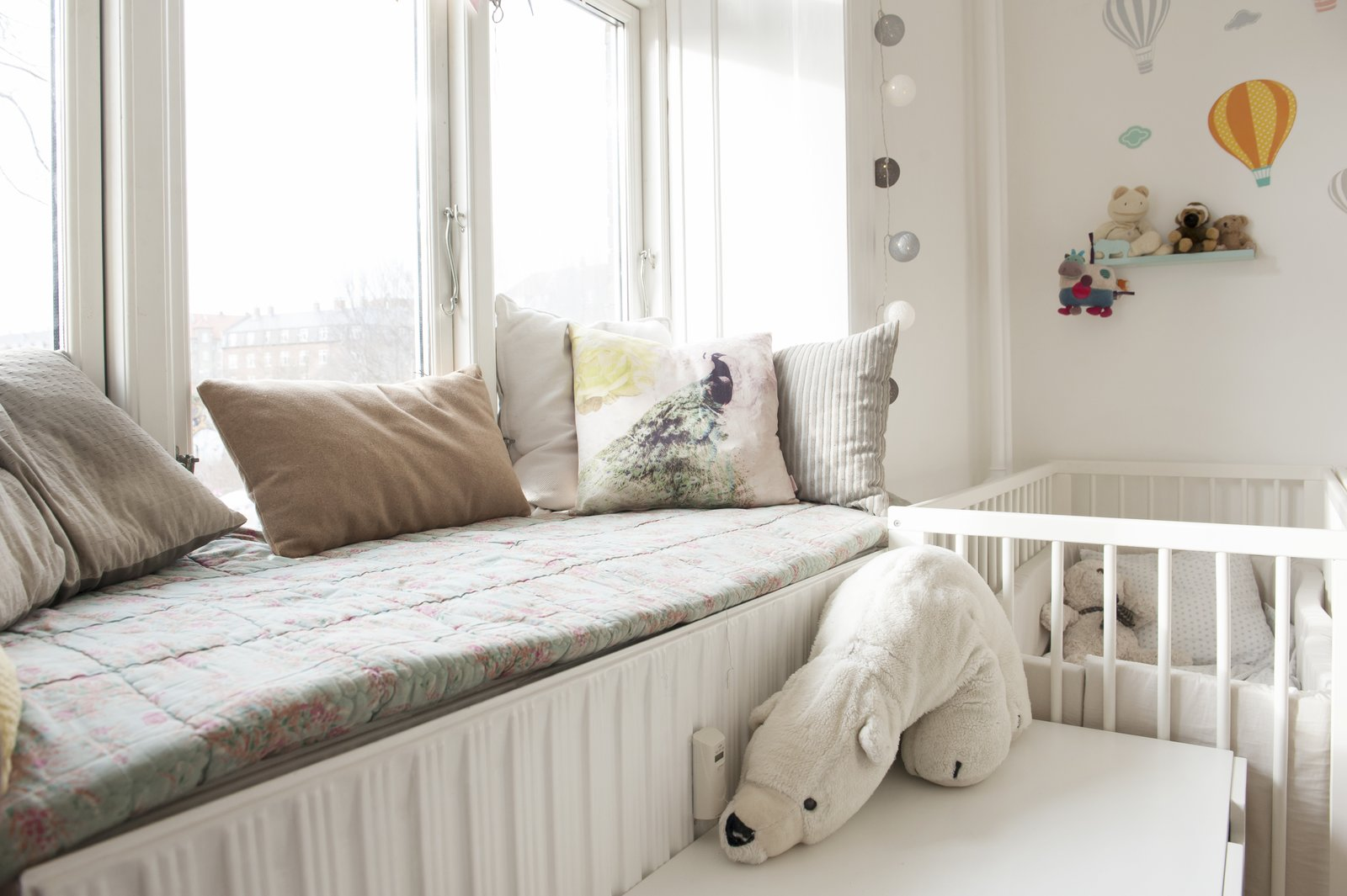 Kids Room, Bed, Bedroom Room Type, and Toddler Age children's bedroom with window perch   Pretty and Sweet Family Flat by Petra Ford