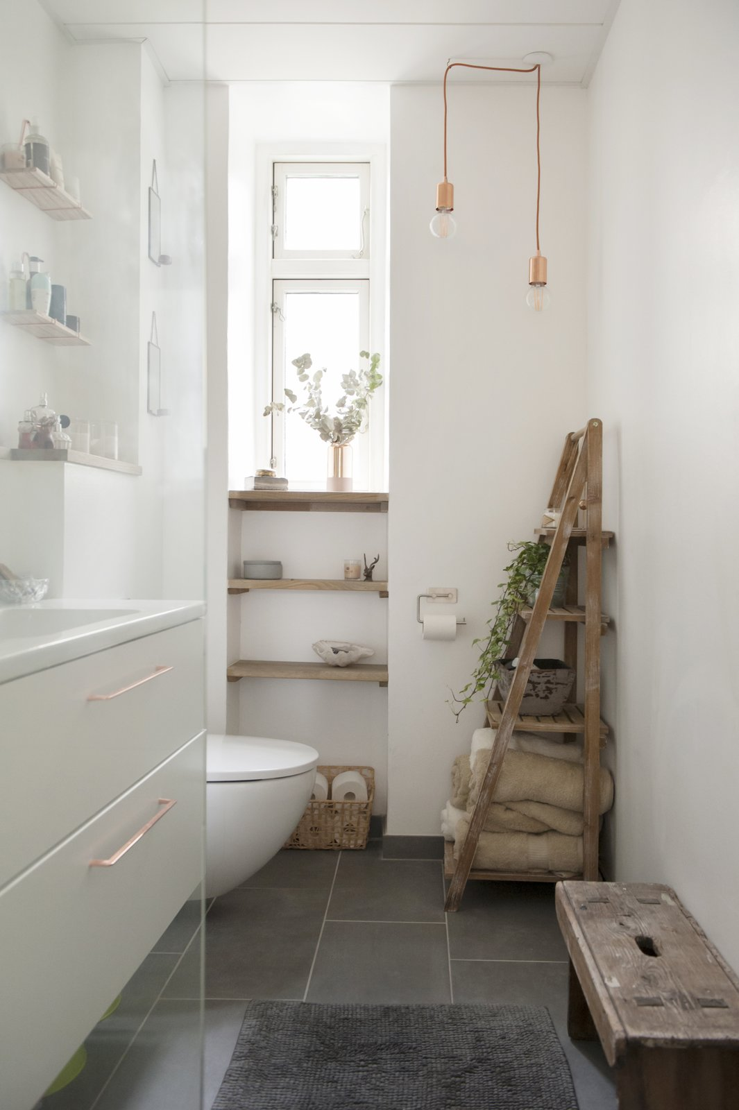 Bath Room, Drop In Sink, Pendant Lighting, and One Piece Toilet earth toned, neutral bathroom with wooden rack, bench, and shelving  Pretty and Sweet Family Flat by Petra Ford