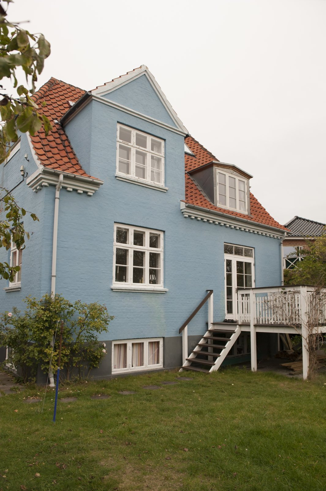 Exterior, House Building Type, Shingles Roof Material, and Brick Siding Material This lovely blue Copenhagen home is a short walk from the sea.  Colorful & Eclectic Danish Home by Petra Ford