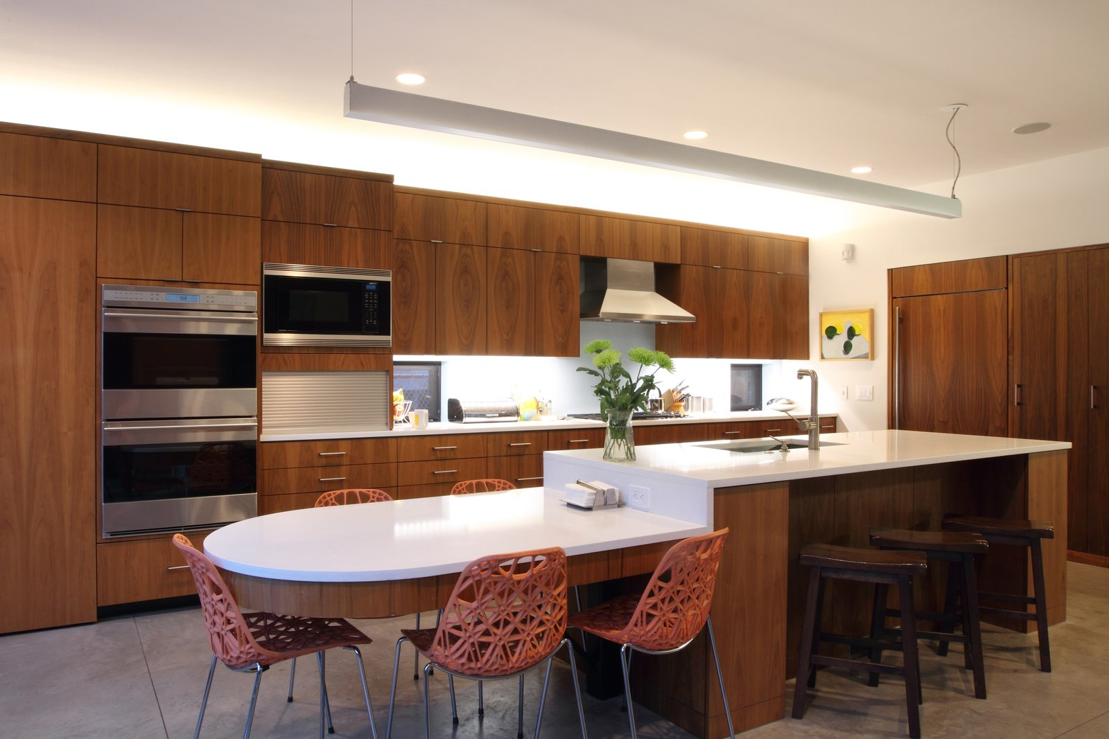 Kitchen, Engineered Quartz Counter, Wood Cabinet, Concrete Floor, Recessed Lighting, Pendant Lighting, Refrigerator, Glass Tile Backsplashe, Microwave, Wall Oven, Range Hood, Cooktops, and Undermount Sink Kitchen  Before House by David Benners Architecture