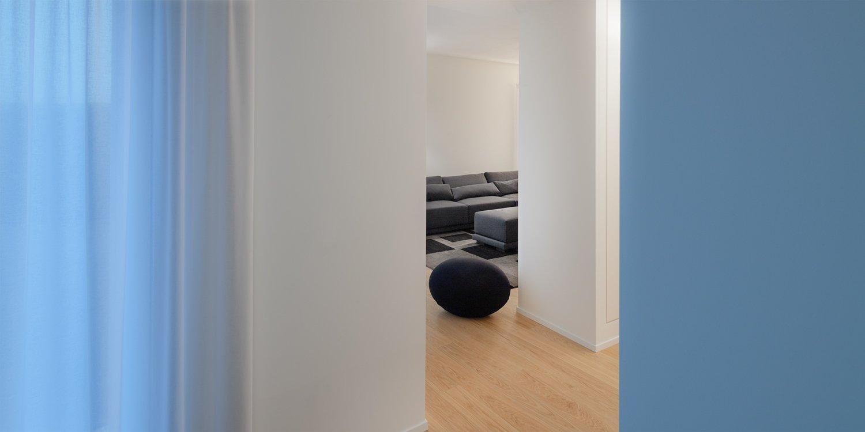 Living Room, Sofa, Medium Hardwood Floor, and Ceiling Lighting Interior  PD House by EXiT architetti associati