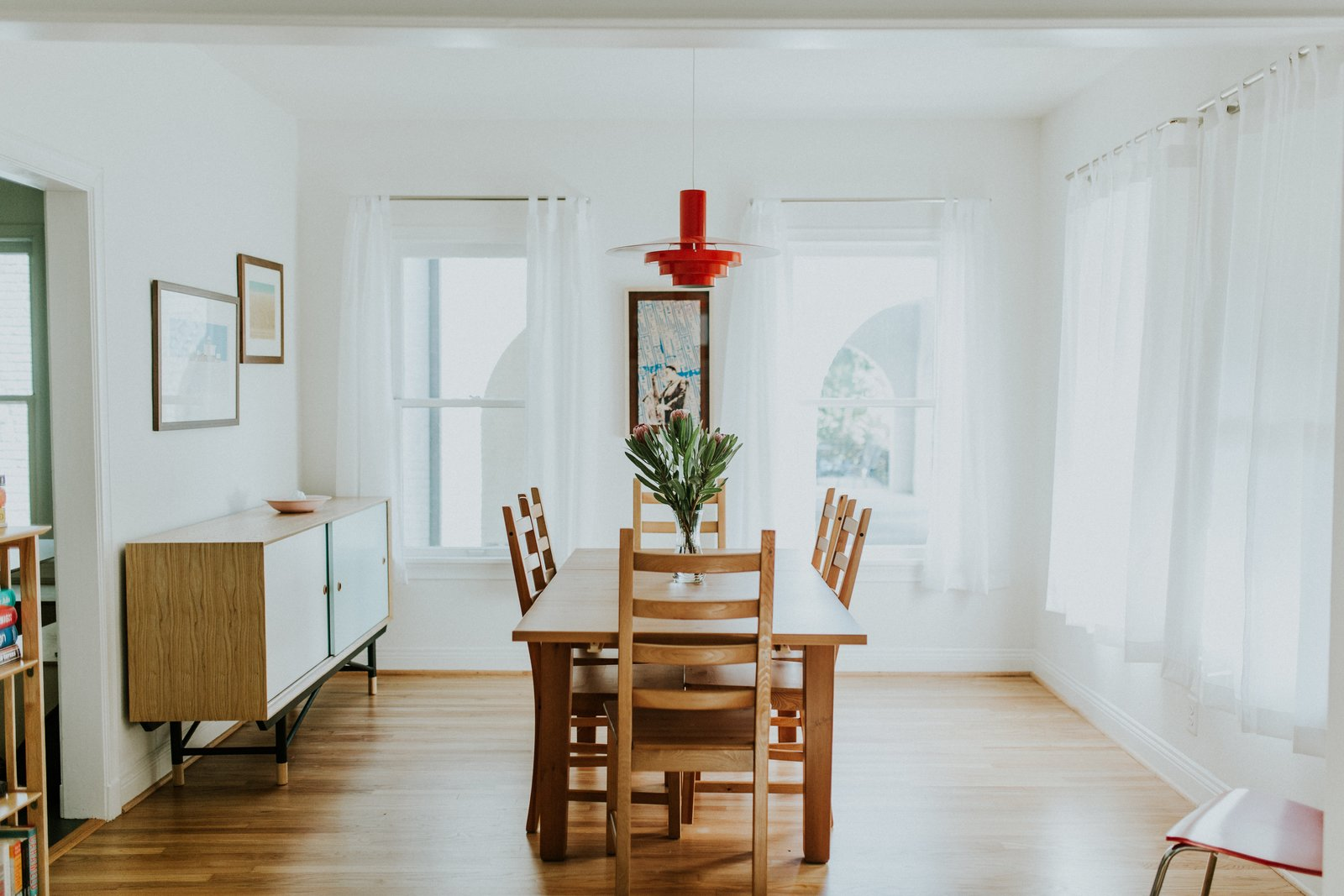Dining Room, Light Hardwood Floor, Pendant Lighting, and Table Dining Room  Best Photos from Oak Cliff Home