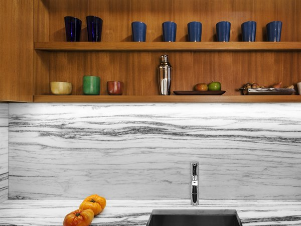 We had the stone counter and backsplash  cut from the same slab of Vermont marble, achieving a continuous graphic pattern.