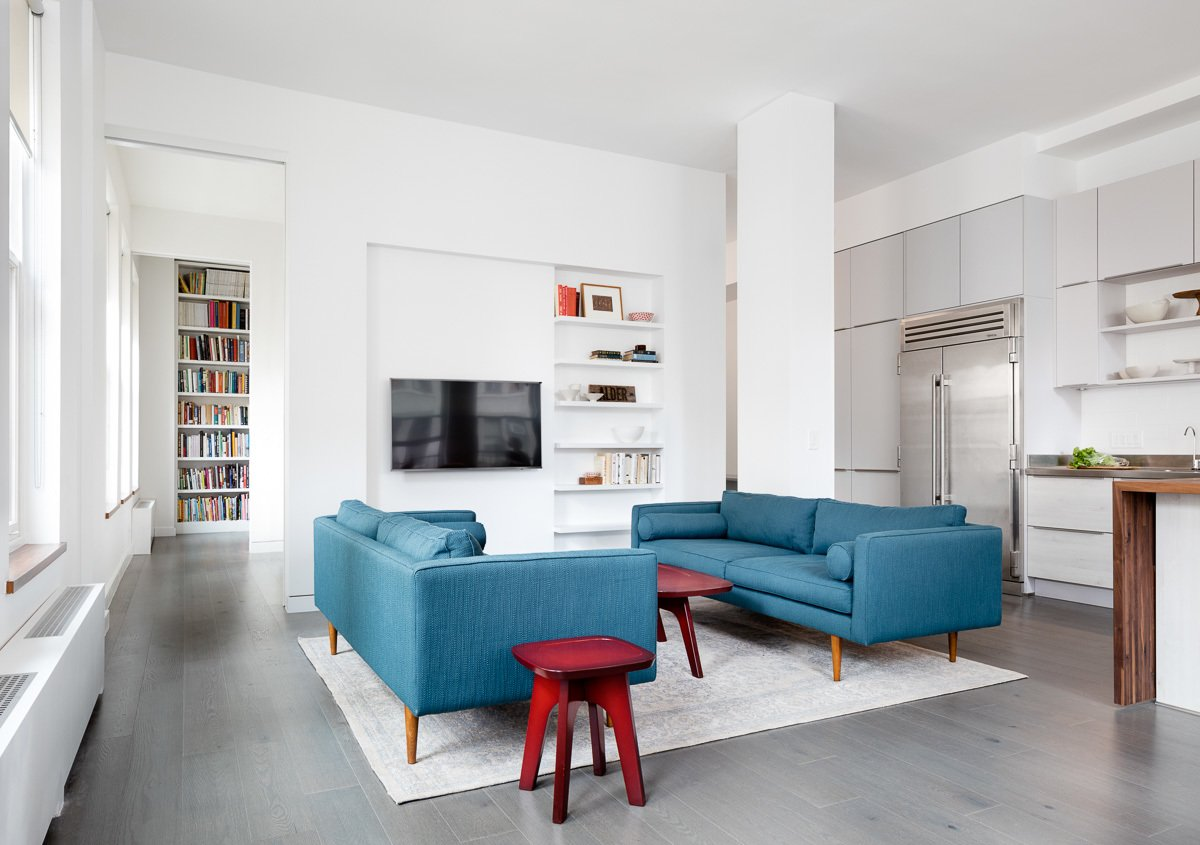 Living Room, Sofa, Coffee Tables, End Tables, and Shelves Two sliding doors can be opened to lend access and visibility to the study, and allow views and light to extend the entire length of the apartment.  5th Avenue Apartment by Verona Carpenter Architects