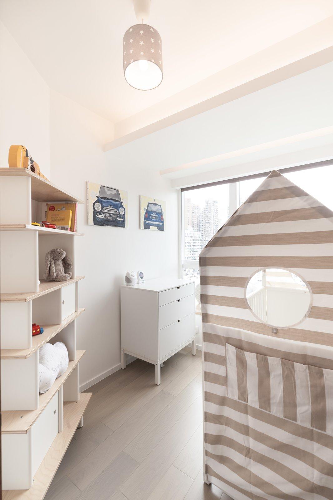 Kids Room, Bedroom Room Type, Storage, and Neutral Gender http://www.cliftonleungdesignworkshop.com/Cherry+Crest+B  Cherry Crest by Clifton Leung