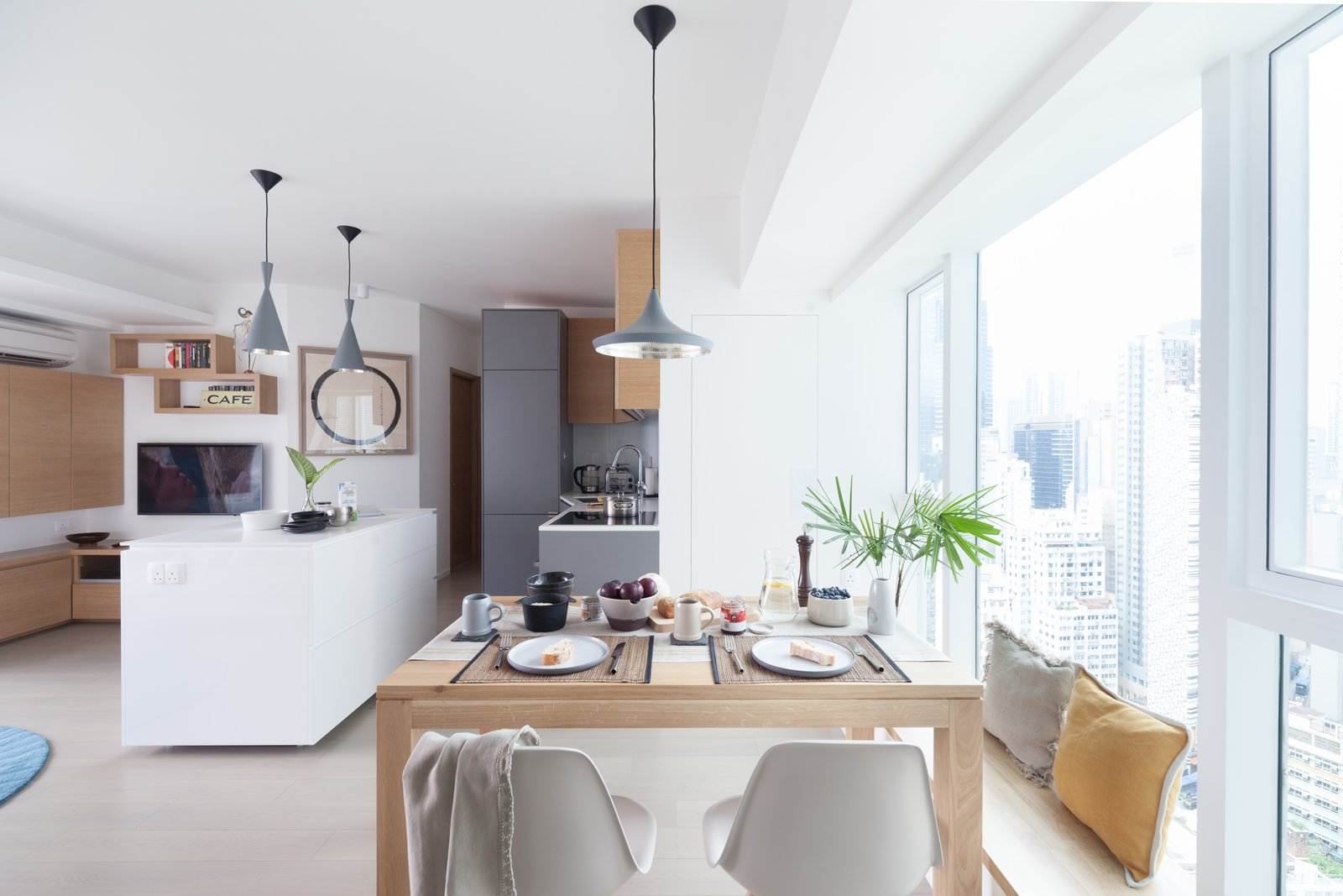 Dining Room, Table, Bench, Pendant Lighting, Storage, Light Hardwood Floor, and Chair http://www.cliftonleungdesignworkshop.com/Cherry+Crest+B  Cherry Crest by Clifton Leung