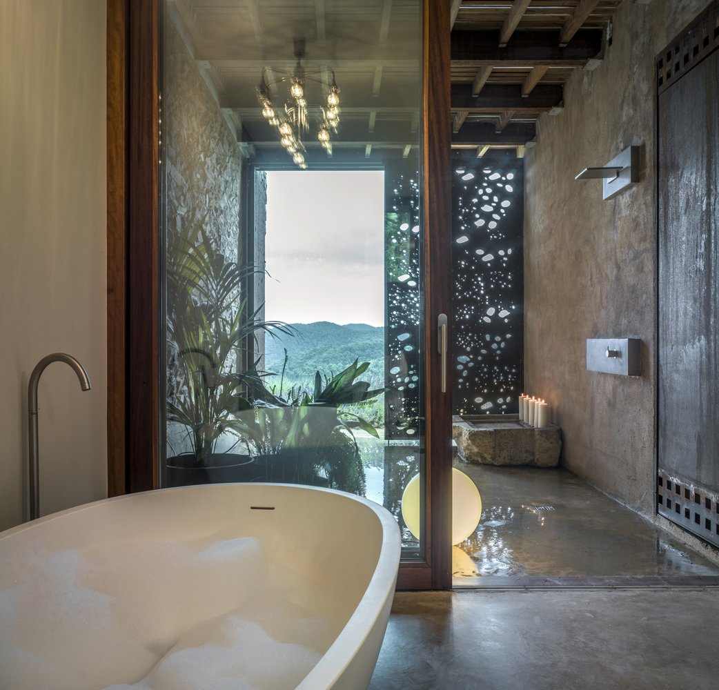Bath Room, Concrete Floor, Freestanding Tub, Open Shower, Floor Lighting, Concrete Wall, Drop In Tub, and Ceiling Lighting Master bathroom with views to the valley-VILLA CP  Best Photos from Villa CP
