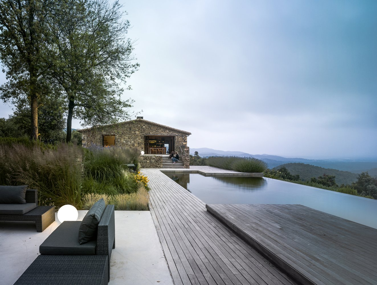 Outdoor, Back Yard, Woodland, Trees, Grass, Gardens, Raised Planters, Walkways, Swimming, Metal, Infinity, Large, Wood, Concrete, Stone, Decking, Metal, Stone, Concrete, and Landscape Exterior with infinity pool-VILLA CP  Outdoor Metal Swimming Wood Photos from Villa CP
