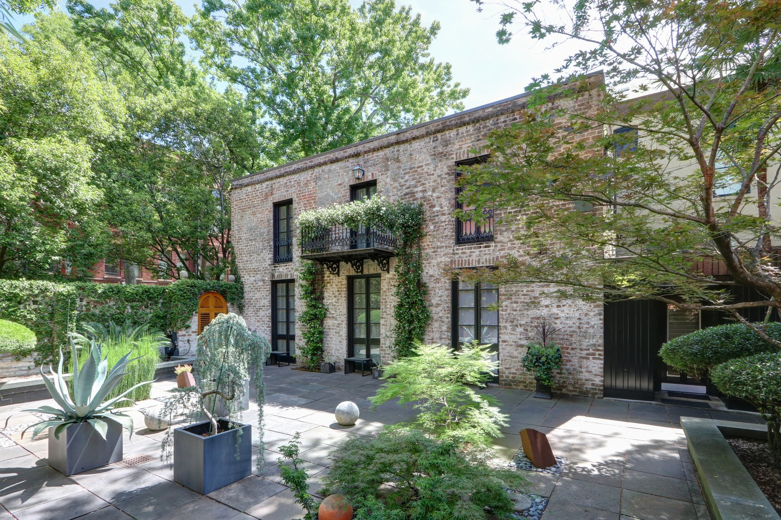 Outdoor, Side Yard, Stone Patio, Porch, Deck, Pavers Patio, Porch, Deck, Hardscapes, Trees, and Stone Fences, Wall Large, meticulously landscaped courtyard  The Hill Gowdy House