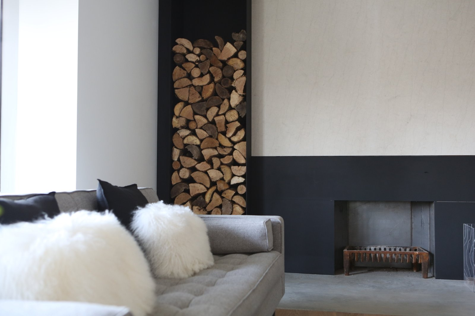 Living Room, Sofa, Concrete Floor, Medium Hardwood Floor, and Wood Burning Fireplace livingroom and existing fireplace renovated  Best Photos from Hudson House | Gillian Green Architect