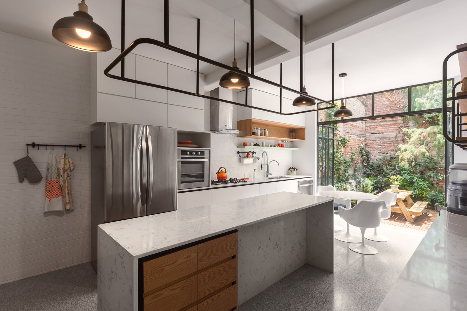 Kitchen, Open, Terrazzo, Subway Tile, Wall Oven, Marble, and Ceiling kitchen   Best Kitchen Wall Oven Ceiling Open Photos from Casa Milton
