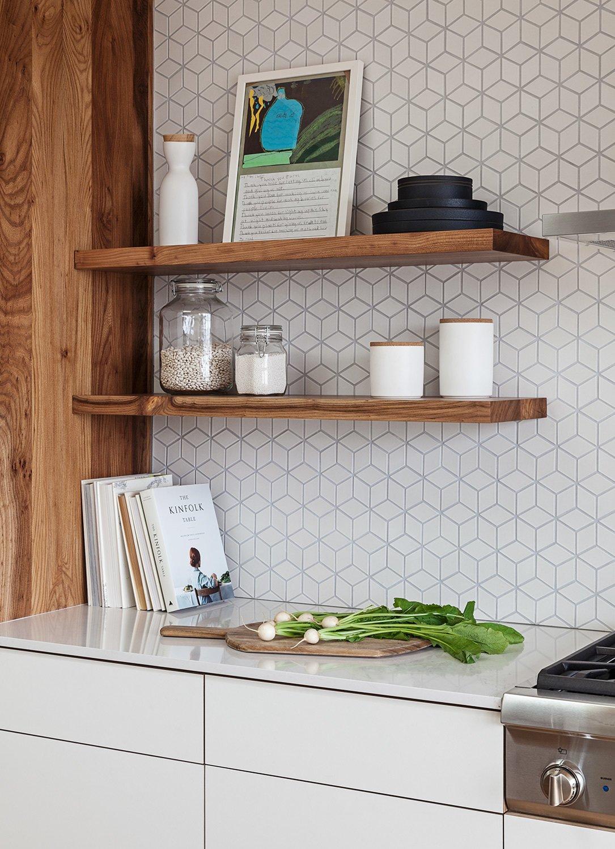 Kitchen, Range, Engineered Quartz, White, Wood, Laminate, and Ceramic Tile Cabinetry and floating shelves by Kaimade, Heath Ceramics wall tile  Kitchen Range Laminate Engineered Quartz Photos from Los Palmos