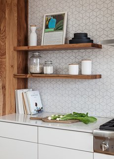 Cabinetry and floating shelves by Kaimade, Heath Ceramics wall tile