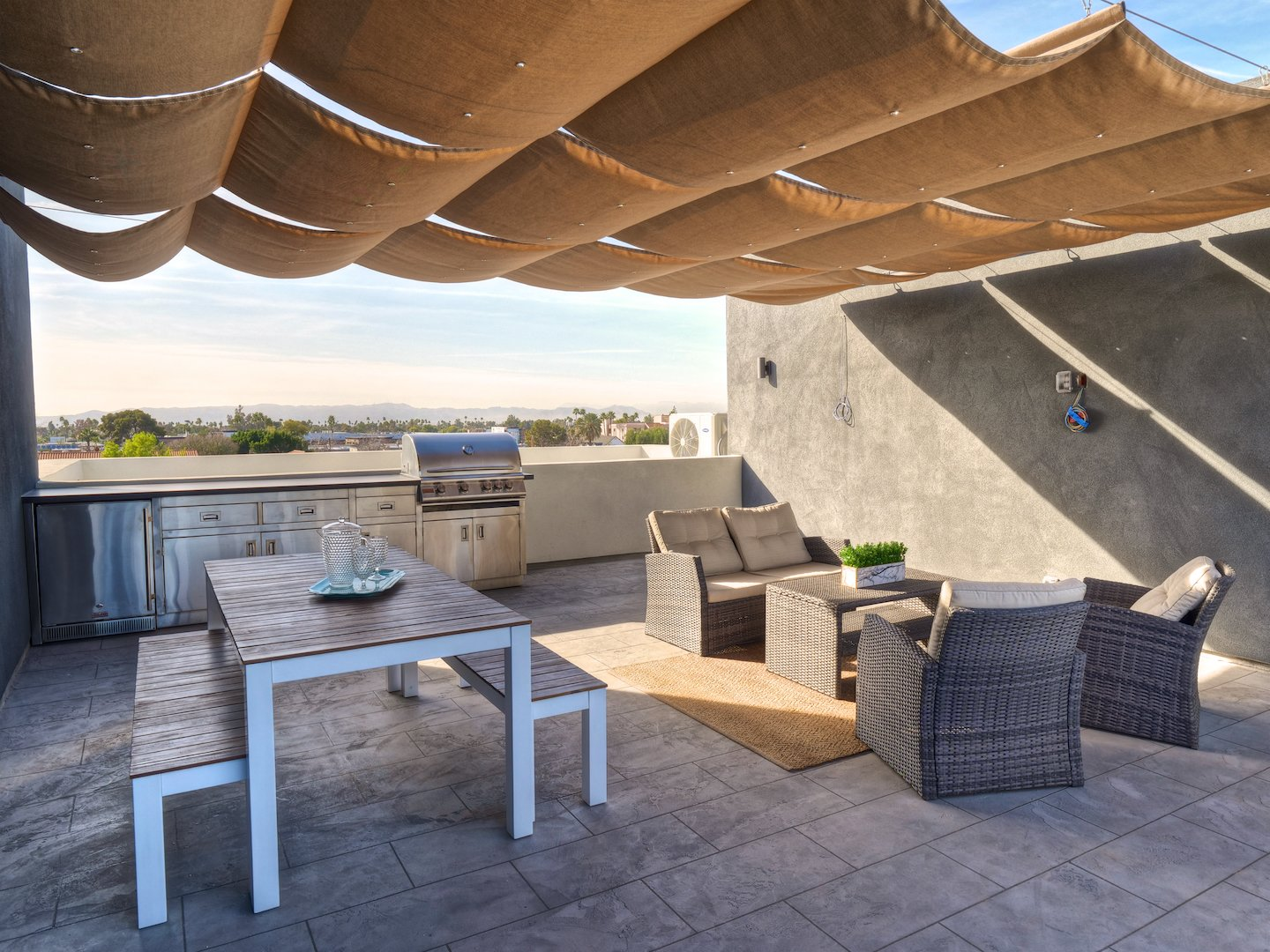 Outdoor, Rooftop, and Large Patio, Porch, Deck Entertain guests on your 440 sqft rooftop deck with built in barbecue and downtown Phoenix views.   Stacks Modern
