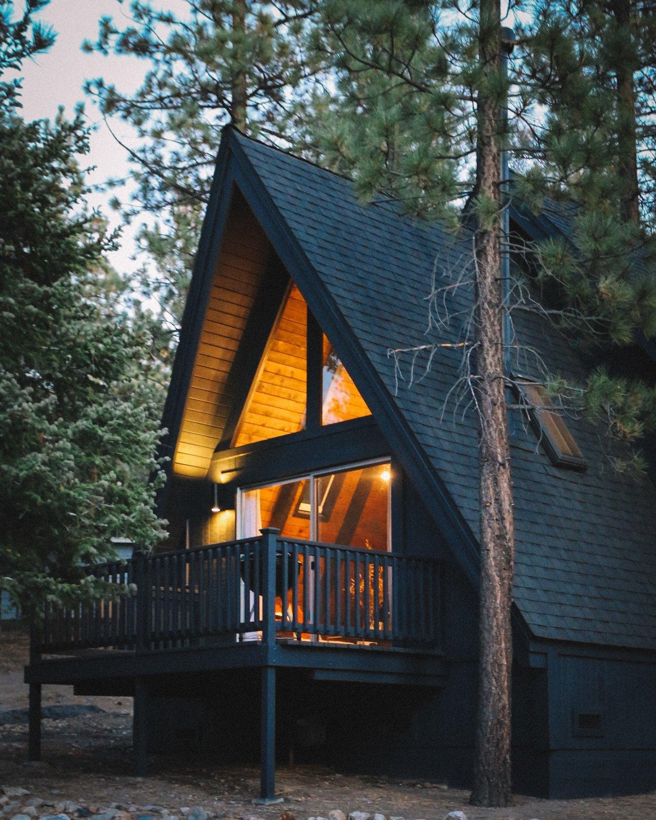 A modern black-on-black A-frame transformation in Big Bear Lake, CA.  Big Bear A-Frame Receives Boho Eclectic Transformation