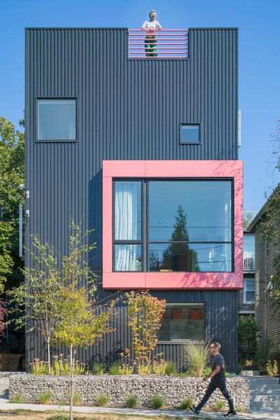 As the name implies, the exterior of Best Practice's Big Mouth House resembles an open-mouthed face with its powder pink framing against the black metal facade.