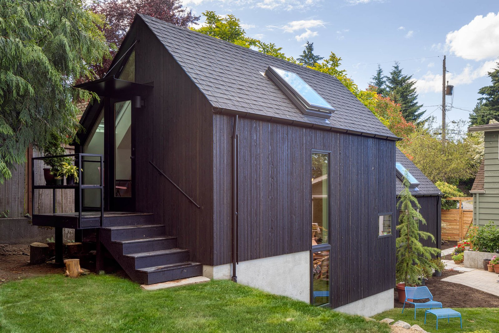 Exterior, House Building Type, Shingles Roof Material, and Wood Siding Material Exterior from the backyard  Granny Pad