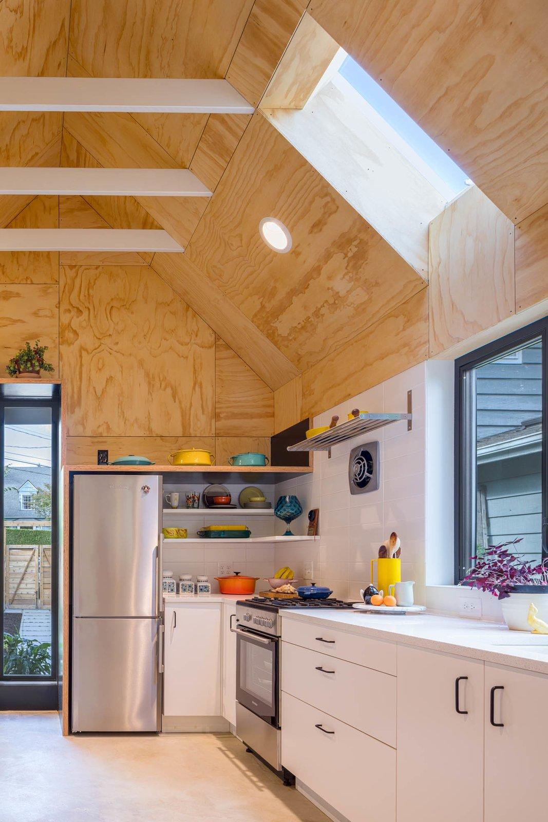 Kitchen, Undermount Sink, Concrete Floor, Recessed Lighting, and White Cabinet Kitchen  Granny Pad