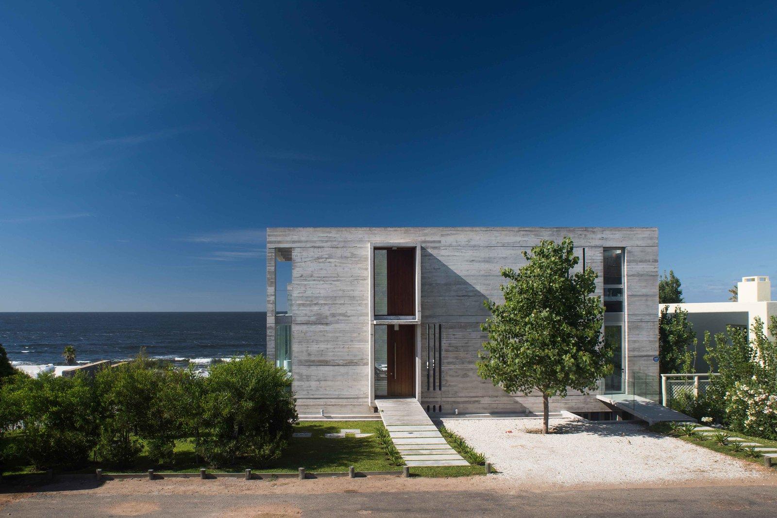 Exterior, House Building Type, Concrete Siding Material, and Beach House Building Type Street Entrance Facade  La Iluminada by MARTIN GOMEZ ARQUITECTOS