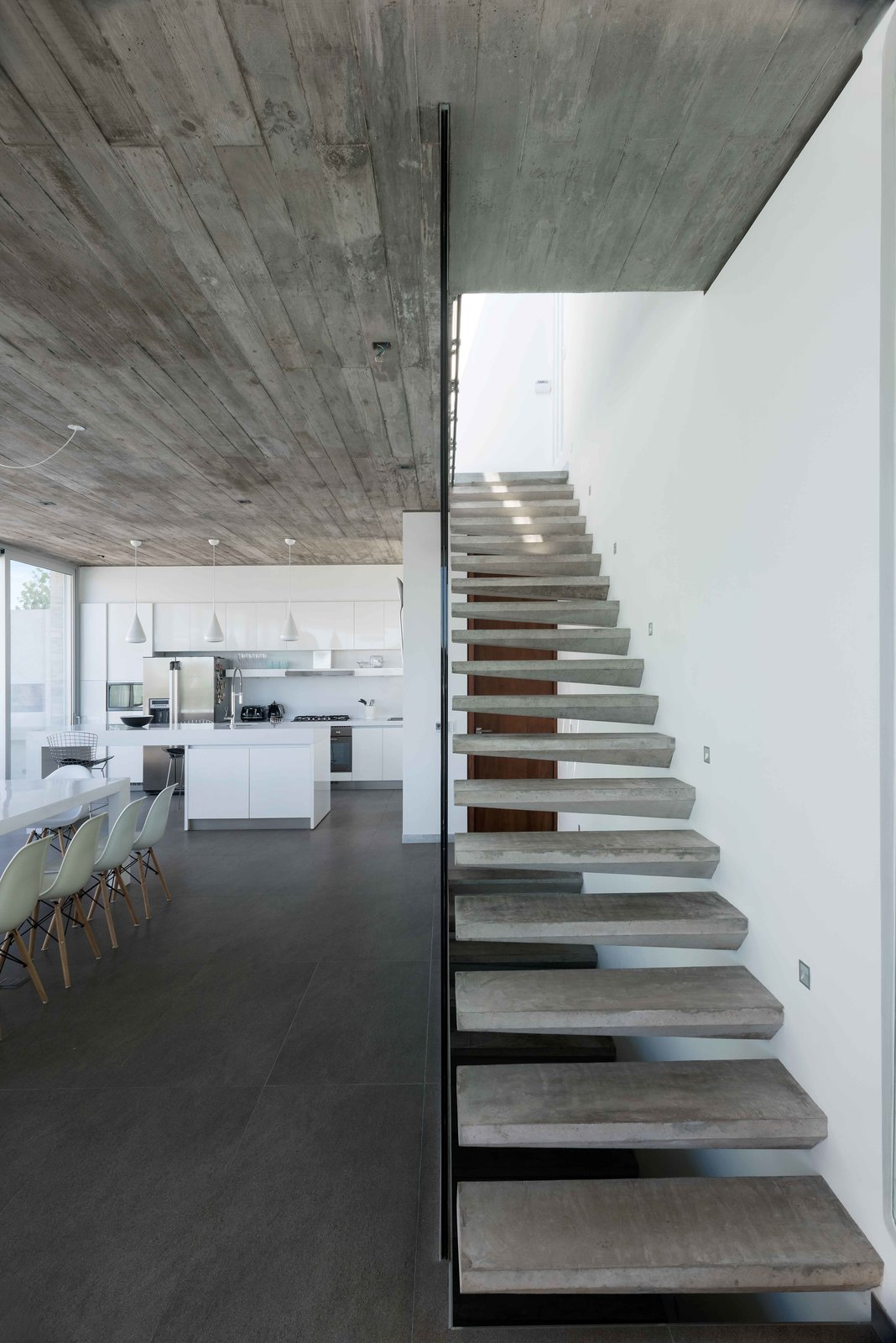 Staircase, Concrete Tread, and Glass Railing Stairs  La Iluminada by MARTIN GOMEZ ARQUITECTOS
