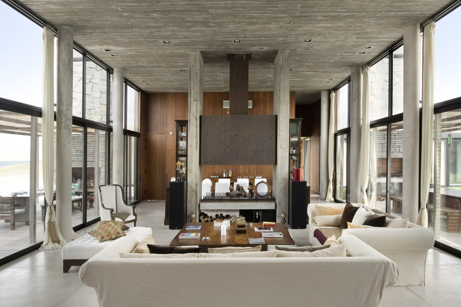 Living, Bench, Chair, Sofa, Coffee Tables, Ceiling, Concrete, and Two-Sided Living Room  Best Living Two-Sided Sofa Photos