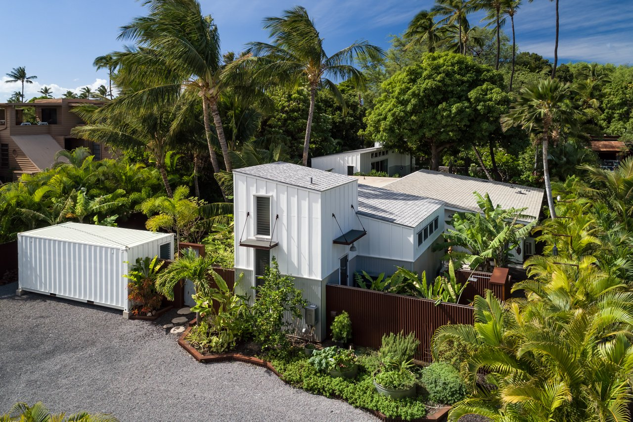 Exterior, Beach House Building Type, and Wood Siding Material Aerial view from the back of the property looking over the 2bed/2bath main house, art studio, and 1bed/1bath detached Ohana and mature apple banana, mango and palm trees  A Modern 1954 Plantation Style Home on Maui