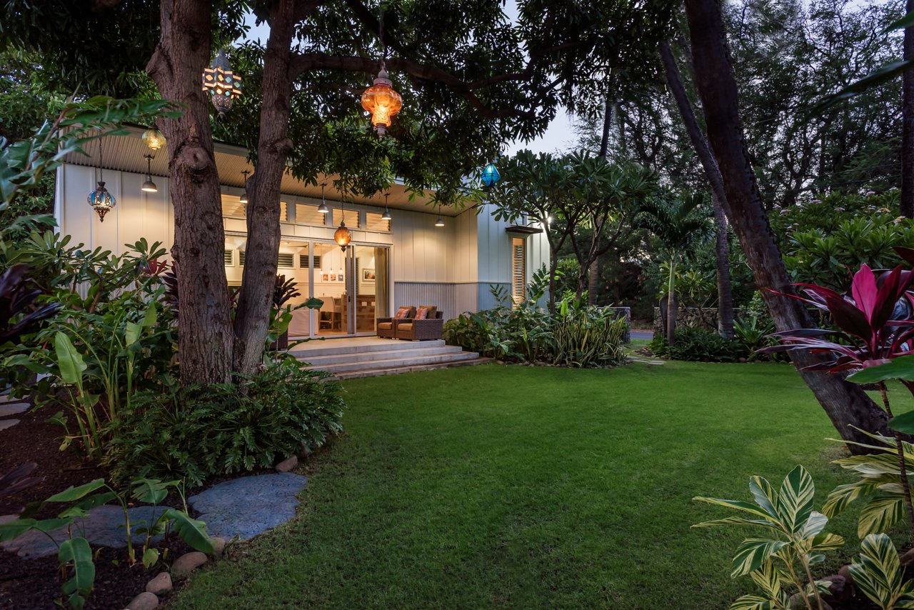 Bedroom, Bed, Chair, Recessed Lighting, and Porcelain Tile Floor Front lawn with vintage light fixtures and Detached 1 Bedroom/1 Bath Ohana that's 600 square feet  A Modern 1954 Plantation Style Home on Maui