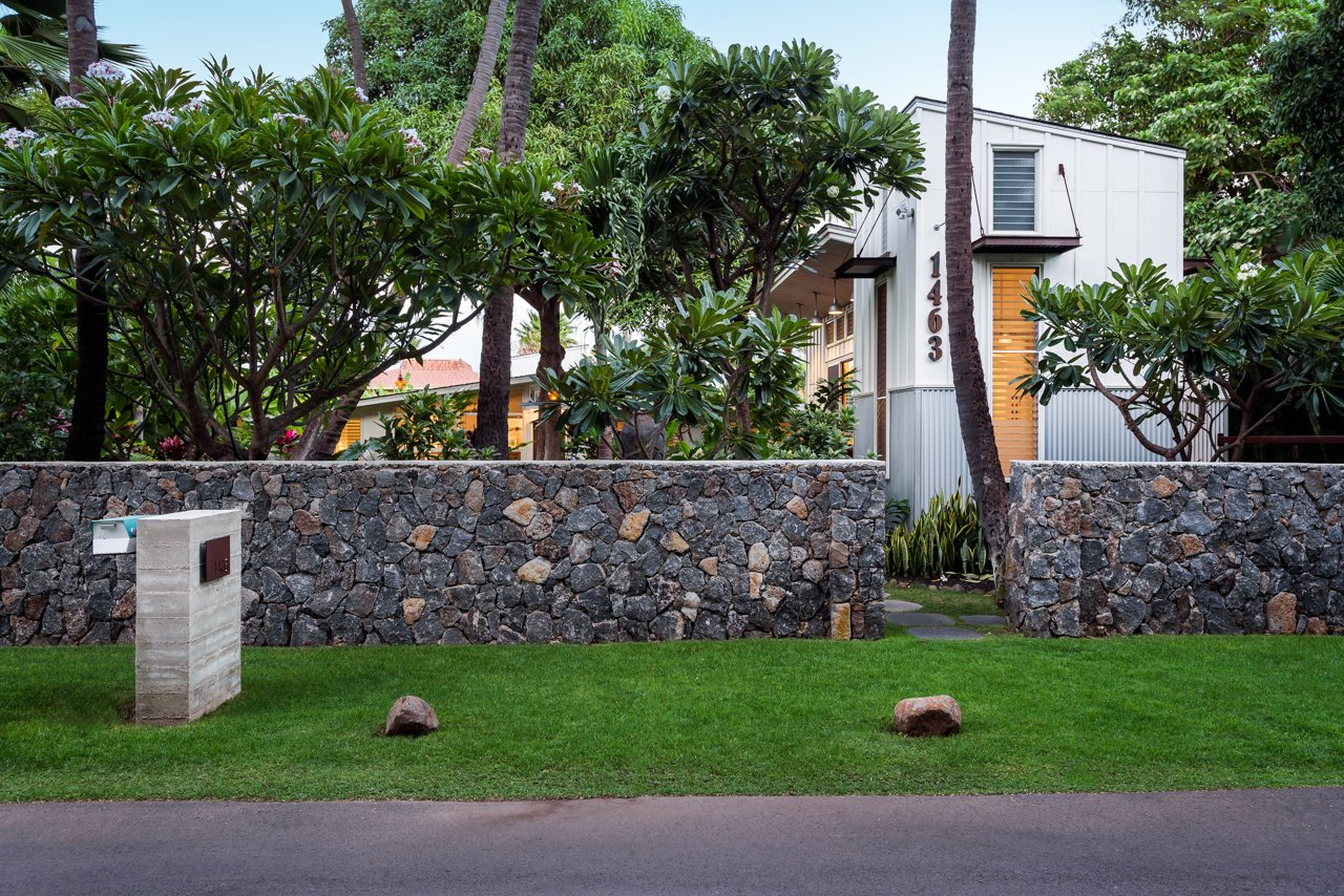Exterior, House Building Type, Beach House Building Type, Shingles Roof Material, Metal Siding Material, Wood Siding Material, and Flat RoofLine Front entrance to property   A Modern 1954 Plantation Style Home on Maui