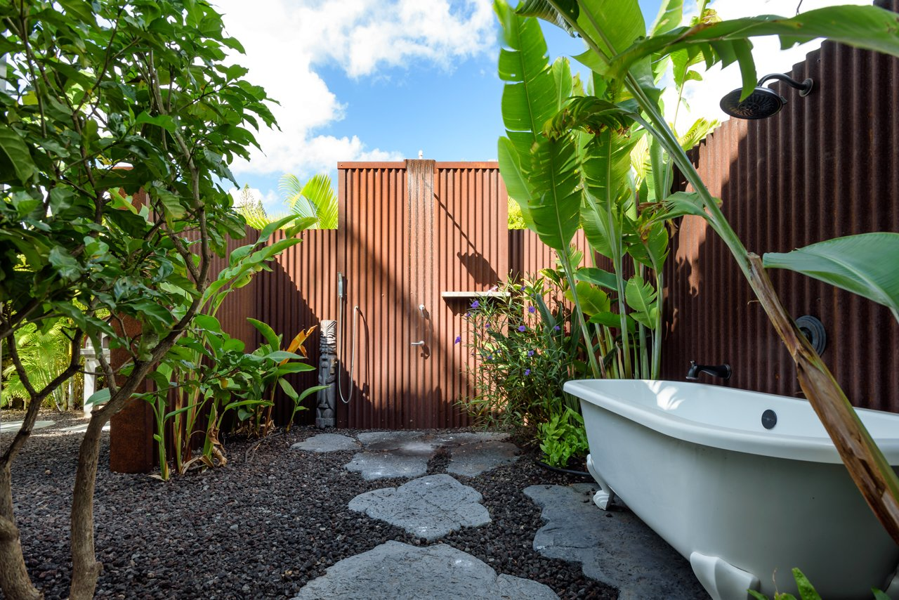Bath Room, Freestanding Tub, Open Shower, and Metal Wall Outdoor rain shower and free standing Victoria & Albert clawfoot tub made of rust-free lava.  A Modern 1954 Plantation Style Home on Maui