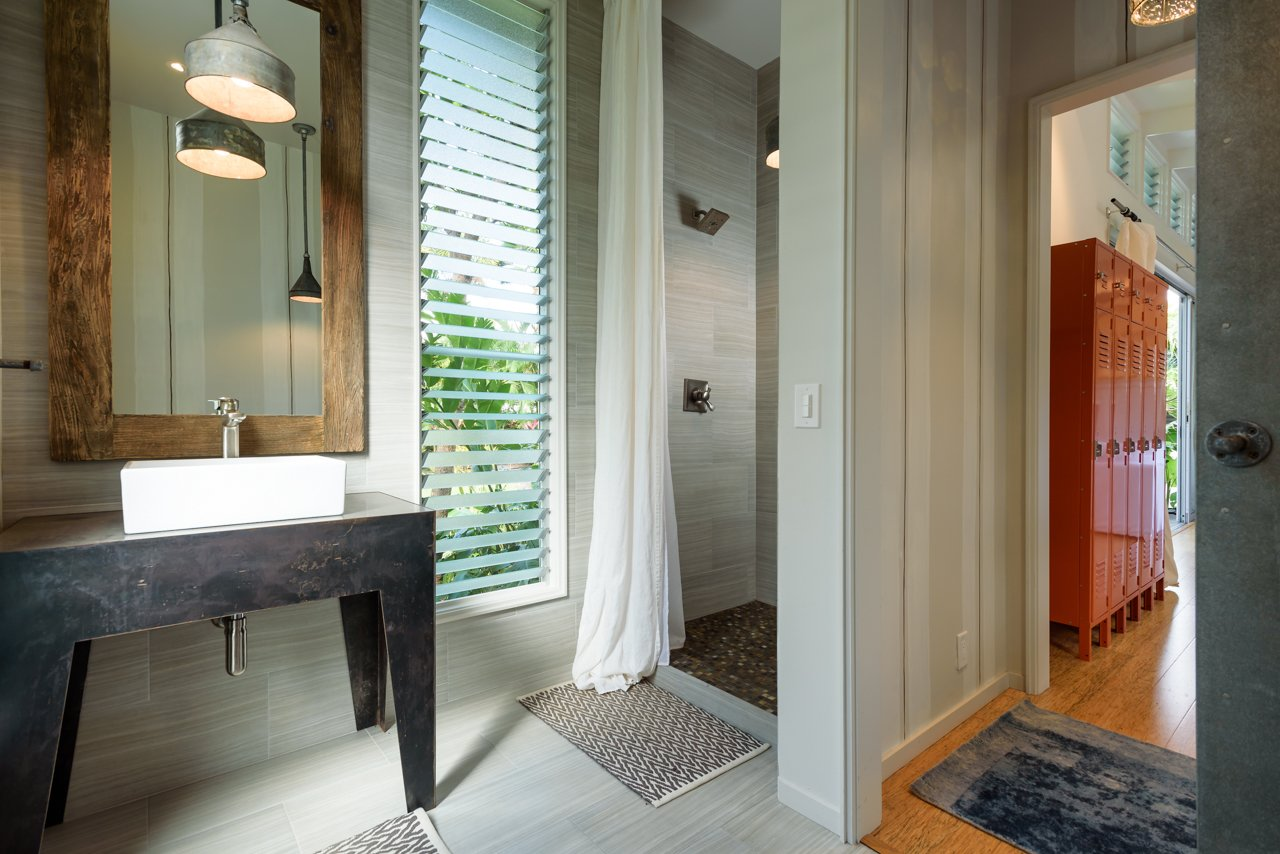 Bath Room, Wood Counter, Porcelain Tile Floor, Vessel Sink, Full Shower, Pendant Lighting, Porcelain Tile Wall, and One Piece Toilet Ohana Bathroom   A Modern 1954 Plantation Style Home on Maui