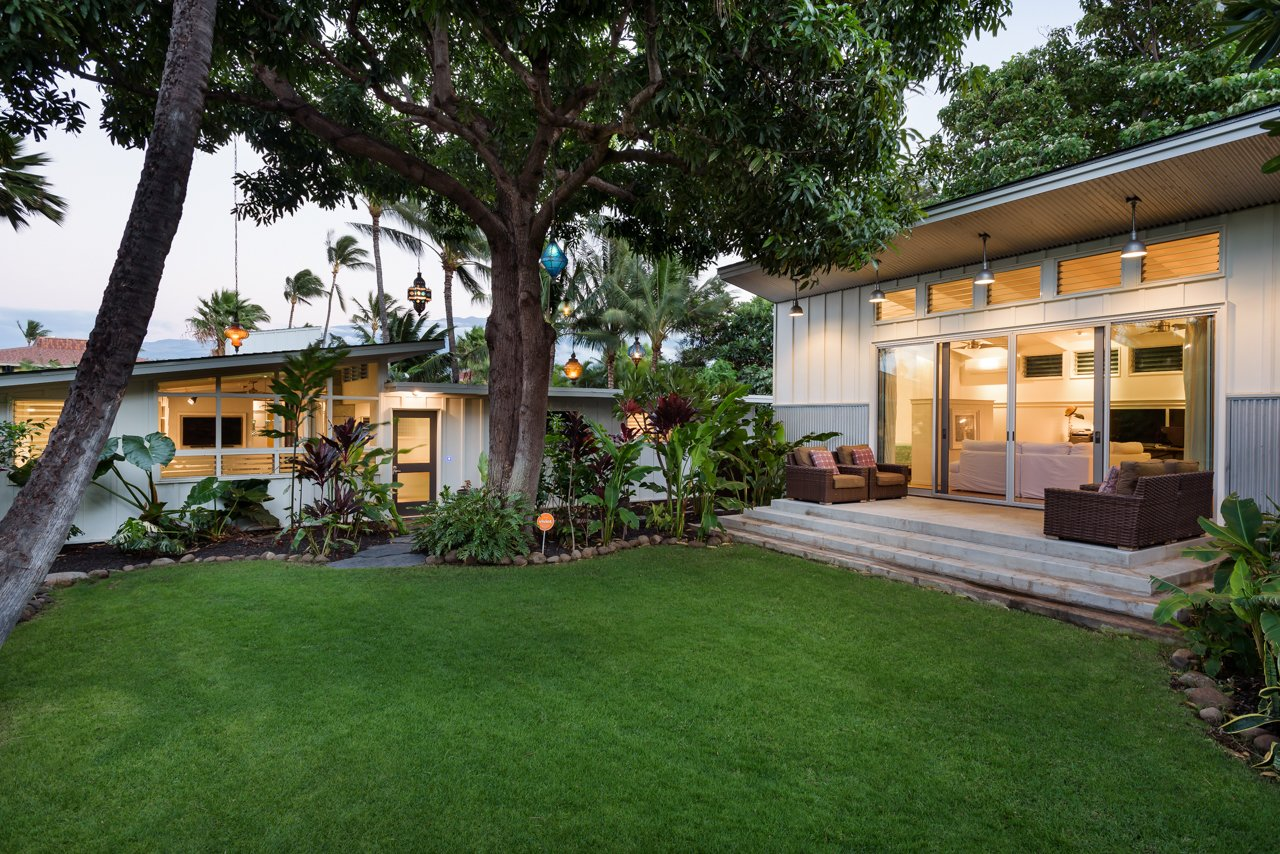 Exterior, House Building Type, Beach House Building Type, Shingles Roof Material, Metal Siding Material, Wood Siding Material, and Flat RoofLine View of the Main house and Ohana from the front yard  A Modern 1954 Plantation Style Home on Maui